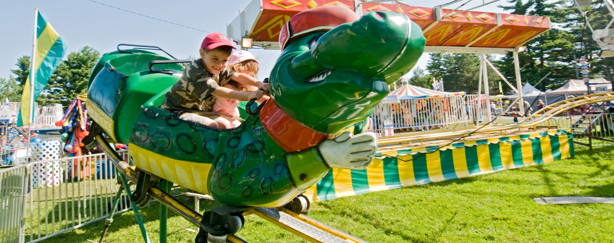 Picture of children on ride at Maxville Fair